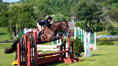 Rider and horse jumping at Teen Ranch